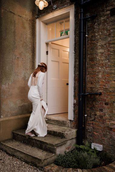 Bride in backless Alexandra Grecco wedding dress