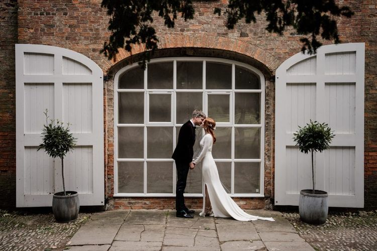 Bride and groom portrait at Aswarby Rectory with bride in Alexandra Grecco wedding dress