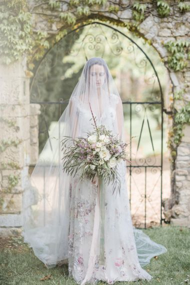Bride in Stephanie Allin Floral Wedding Dress  and Megan Therese Couture Tulle Wedding Veil