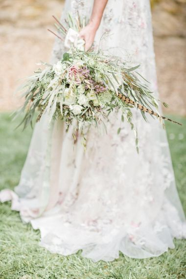 Romantic Wedding Bouquet with Foliage, Pheasant Feather and Spring Flowers