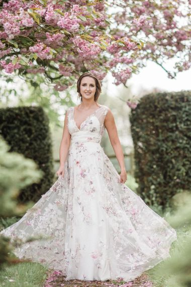 Beautiful Bride Twirling in a Floral Wedding Dress
