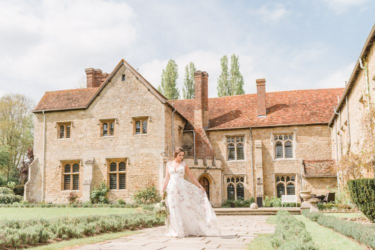 Bride in Stephanie Allin Floral Wedding Dress Walking the Grounds of Notley Abbey
