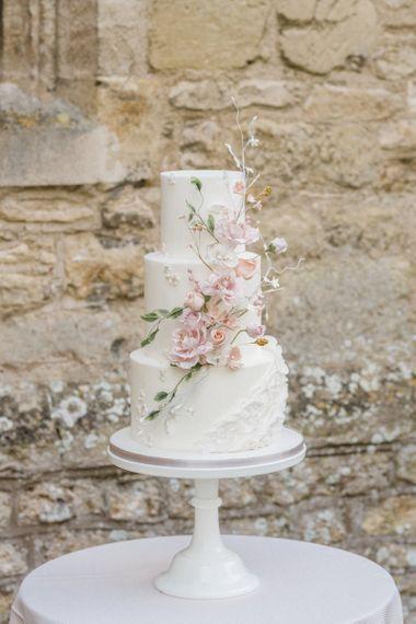 Elegant White Wedding Cake with Floral Decor