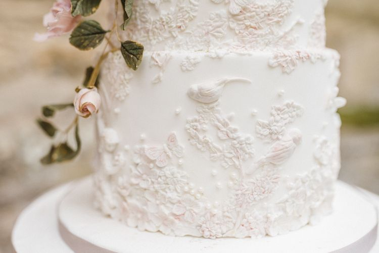 Elegant White Wedding Cake with Floral Decor by Gifted Heart Cakes
