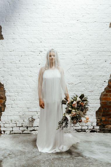 Bride in Sheer Wedding Veil and Minimalist Wedding Dress