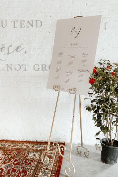 Minimalist Table Plan with Calligraphy Font on an Easel