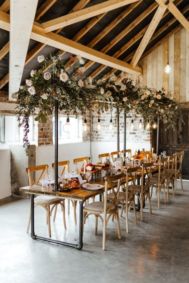 Rustic Tablescape with Edison Bulb Installation and Eco-friendly Flowers