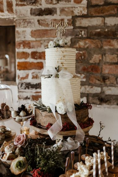 Two Tier Wedding Cake with Laser Cut Cake Topper on a Rustic Cake Stand