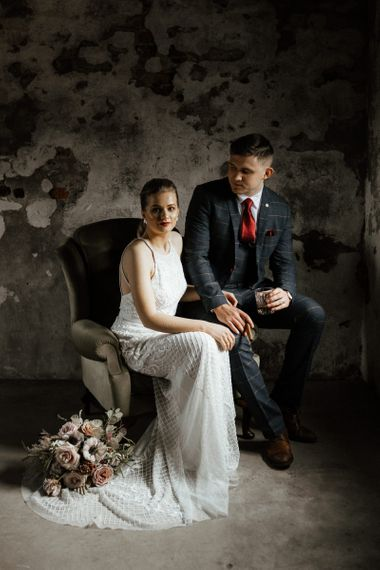 Bride and Groom Sitting on a Chair
