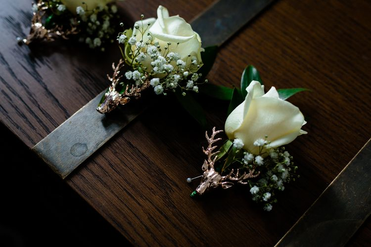 White Rose and Gypsophila Buttonholes with Stag Pins