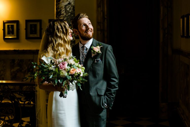 Bride in Satin Wedding Dress with Finger Waves and Groom in Tailored Suit