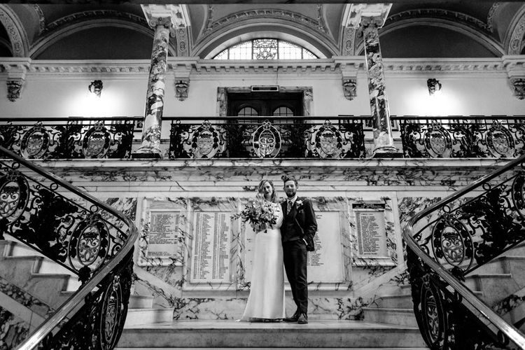 Bride in Vintage Wedding Dress and Groom in Tailored Suit  at Stockport Town Hall