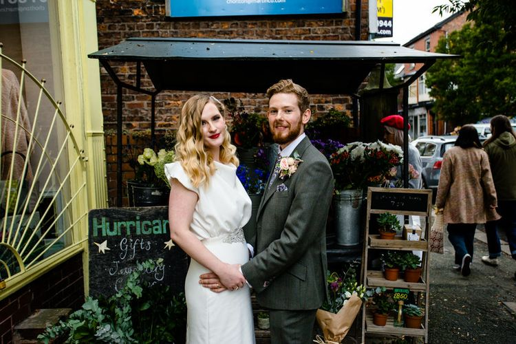 Vintage Bride with Satin Wedding Dress, Finger Waves and Red Lipstick, Holding Grooms Hand in Tailored Suit