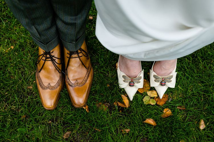 Bride in Bee Brooch Gucci Shoes and Groom in Jeffrey West Brown Brogues
