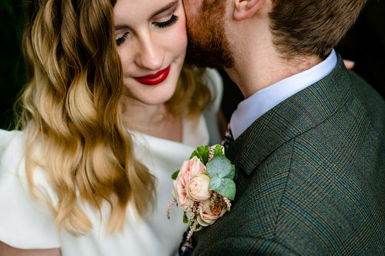 Close Up of Brides Vintage Hair and Makeup and Grooms Pink Rose Buttonhole