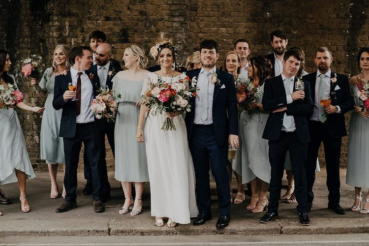 Bride and groom with wedding party at Islington town hall wedding
