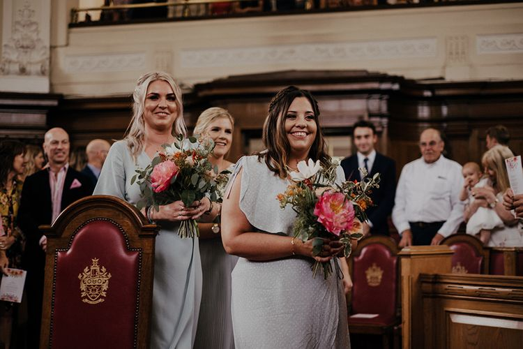 Bridesmaid walk up the aisle for ceremony