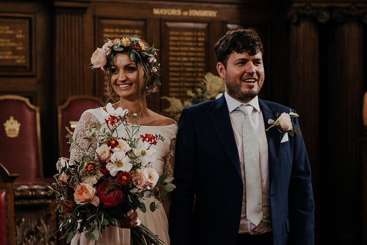 Bride and groom make their way out of Islington town hall wedding ceremony