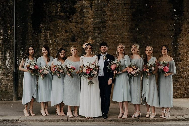 Bridal party in blue mismatched bridesmaid dresses for Islington town hall wedding