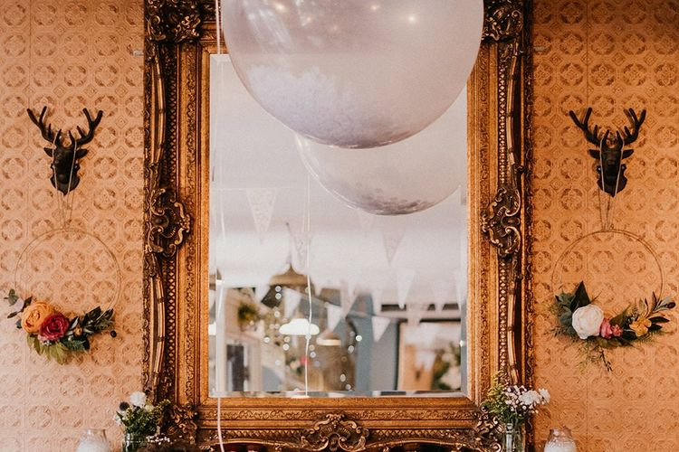 Wedding decor ideas with flower hoops and confetti balloons
