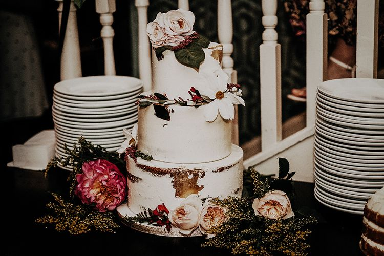Beautiful tiered wedding cake with floral decor