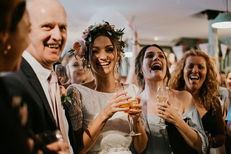 Bride enjoys a drink with guests