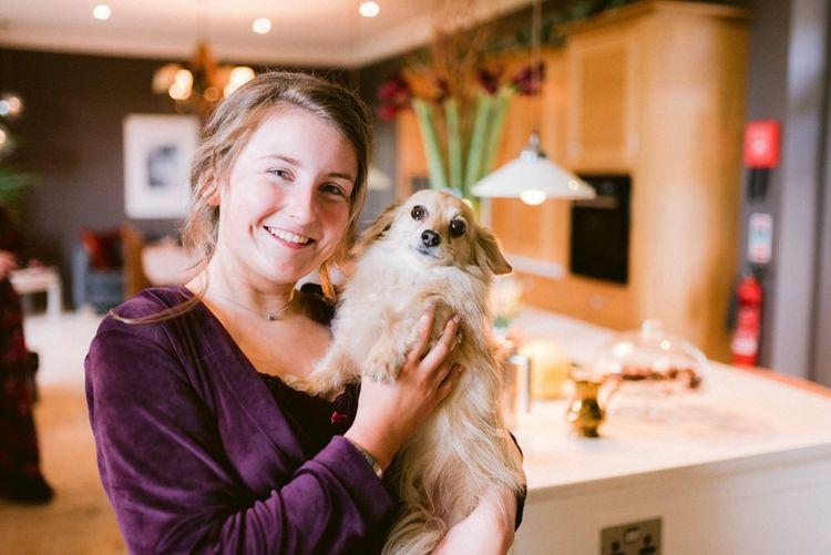 Bridesmaid with family pets at wedding
