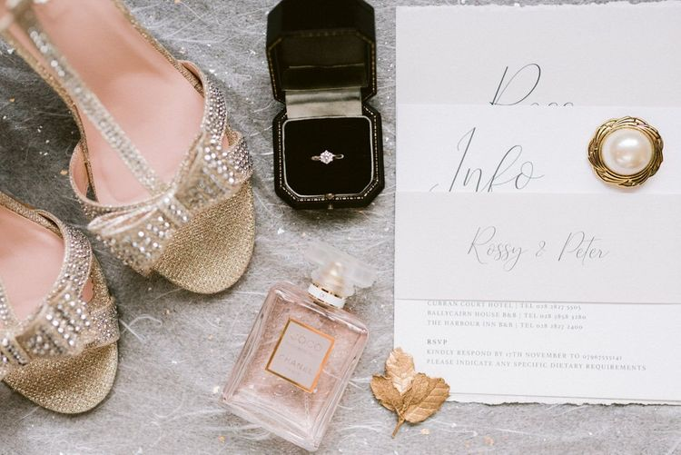 Gold wedding shoes with bridal accessories