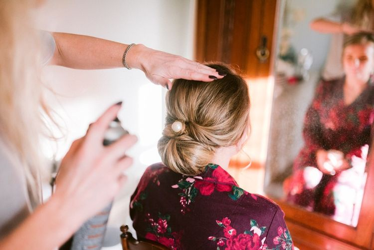 Bridal undo with pearl hair piece