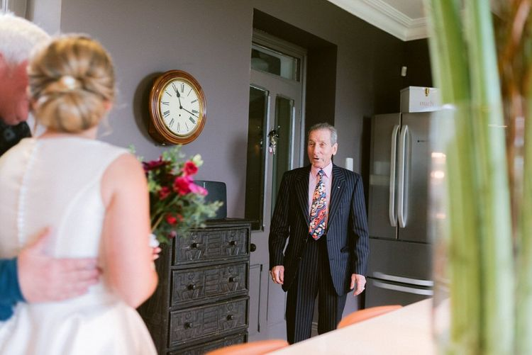 Brides father sees her for the first time in her dress