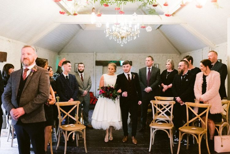 Bride enters intimate Christmas wedding ceremony