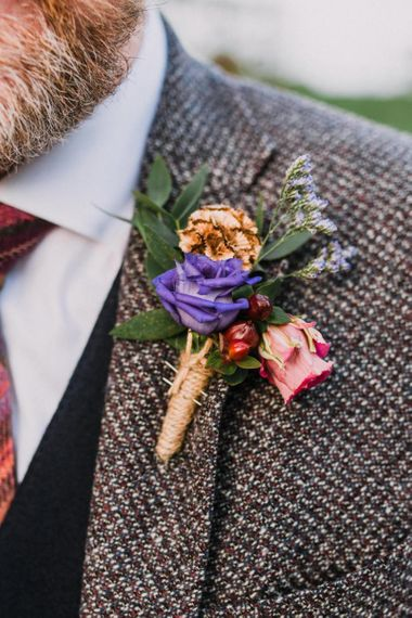 Beautiful buttonhole for groom at Christmas wedding