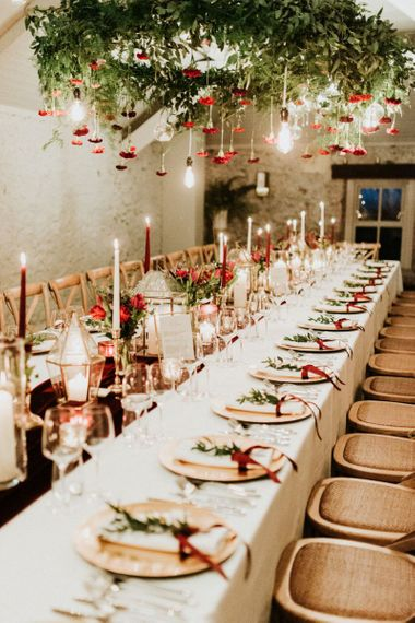 Table decor with candles and flowers at Christmas wedding