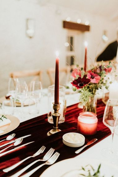 Table decor with candles and flowers at winter wedding
