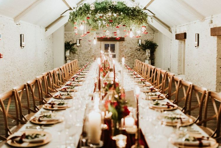Foliage and flower chandelier  at Christmas wedding