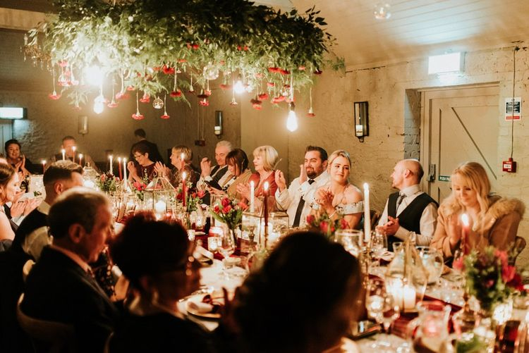 Guests enjoy fine dining at Christmas wedding