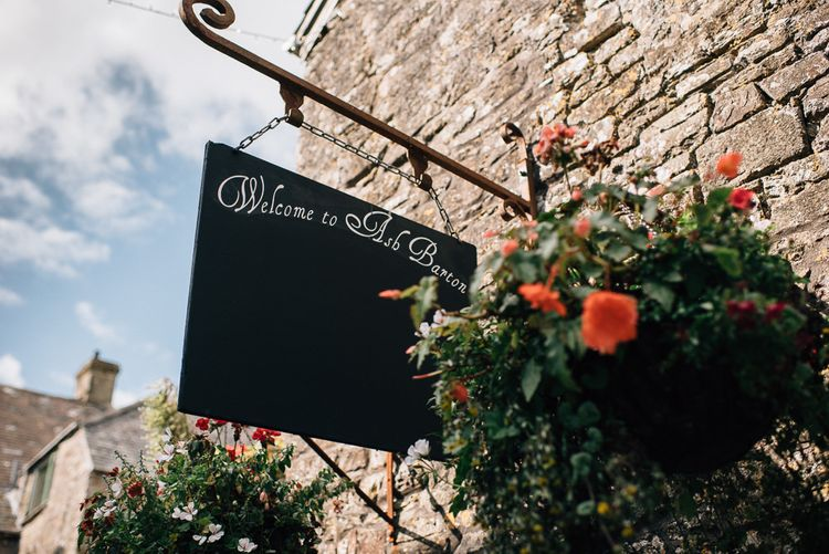 Hanging Wedding Venue Sign with Hanging Basket of Flowers