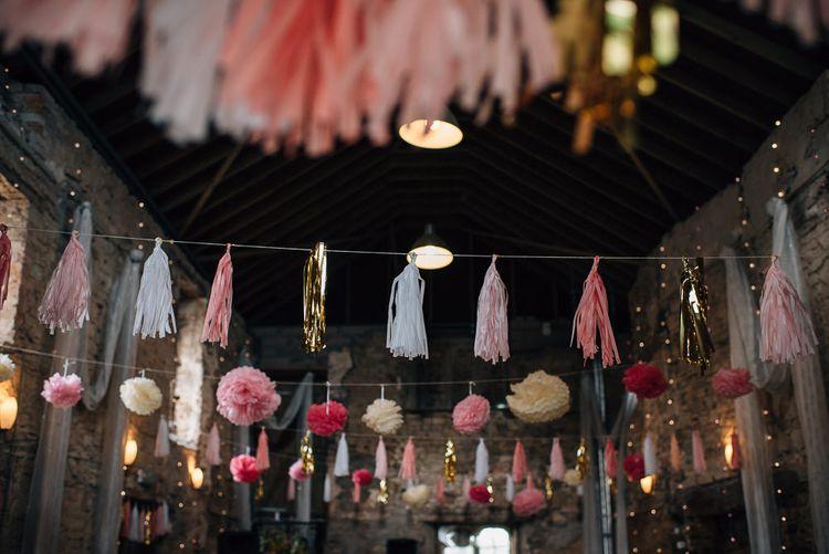 Strung Up Tissue Tassels and Pom Pots Decorating Wedding Venue