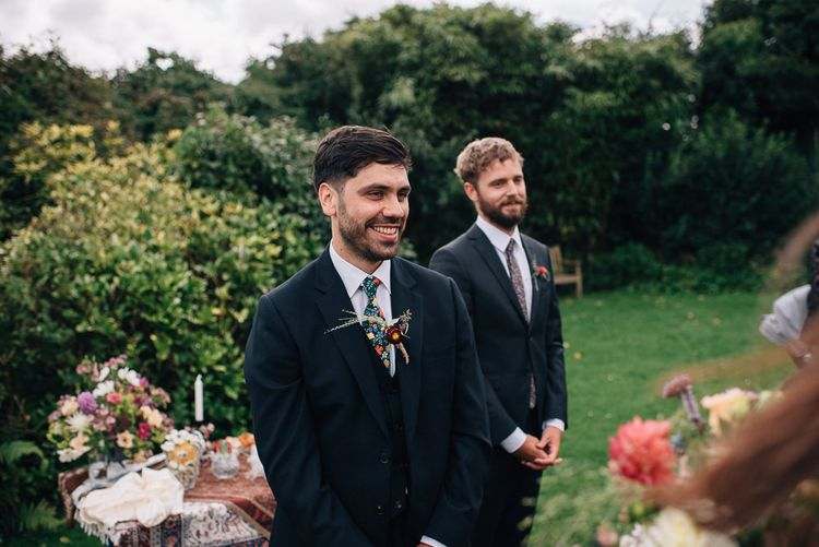 Groom Standing at The Altar in Paul Smith Suit and Liberty Print Tie