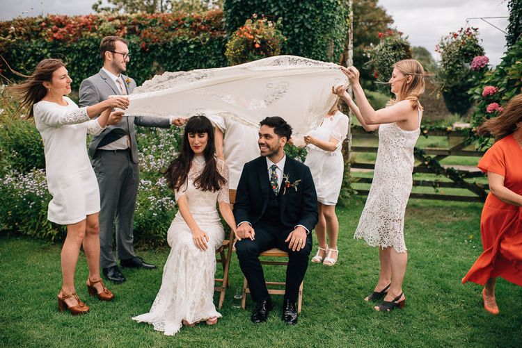 Persian Wedding Ceremony Traditions with Bride in Catherine Deane Wedding Dress and Groom in Paul Smith Suit