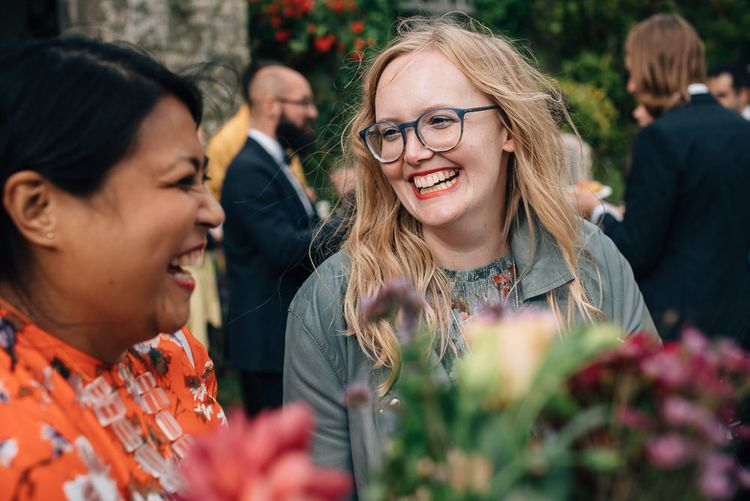 Wedding Guests Laughing During Drinks Reception