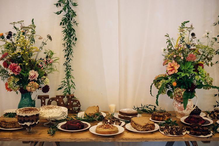 Dessert table with Wild Flower Arrangements on Large Vases
