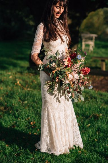 Bride in Catherine Deane Wedding Dress with Wild Flower Bouquet