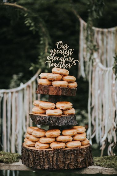 ring doughnuts on wooden cake stand