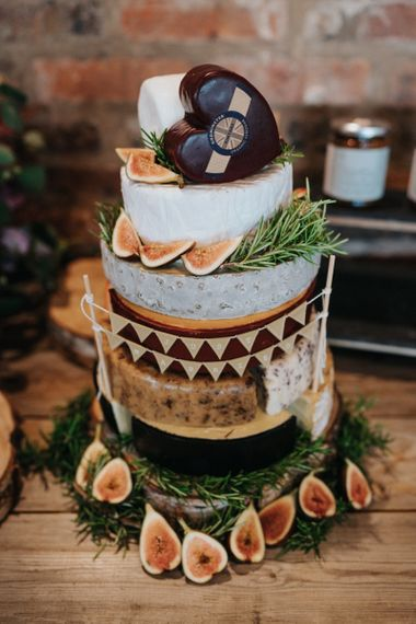 Layer cheese tower alternative wedding cake with bunting decor