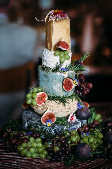 Colourful cheese tower wedding cake decorated with figs - rustic wedding cakes