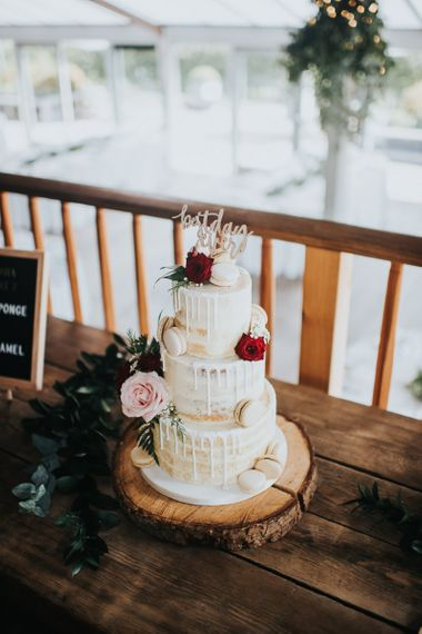 Drip wedding cake decorated with macaroons