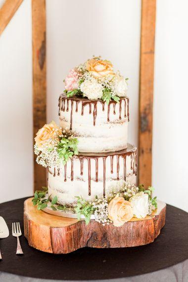 Semi naked drip wedding cake with chocolate sauce