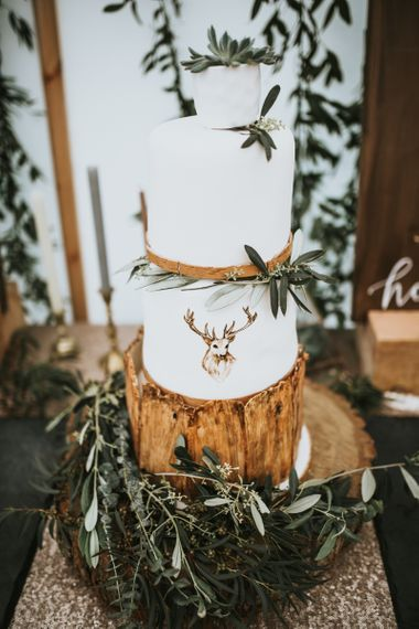 Rustic wedding cake on wooden cake stand with stag emblem - rustic wedding cakes