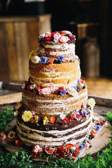 Naked wedding cake with different flavoured tiers